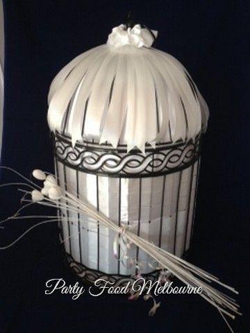 Beautiful birdcages as wishing wells