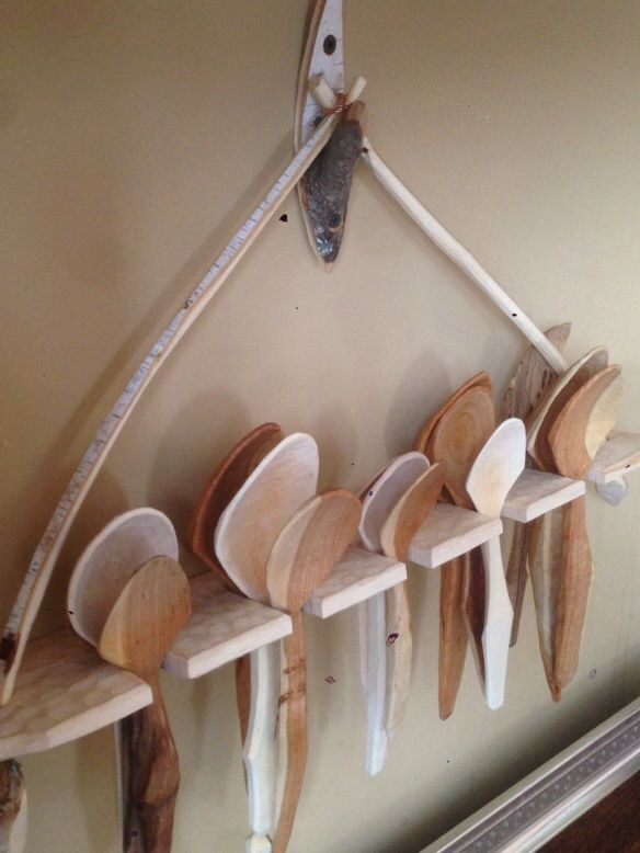 Rustic hand carved spoons and rack. Love the hook too.