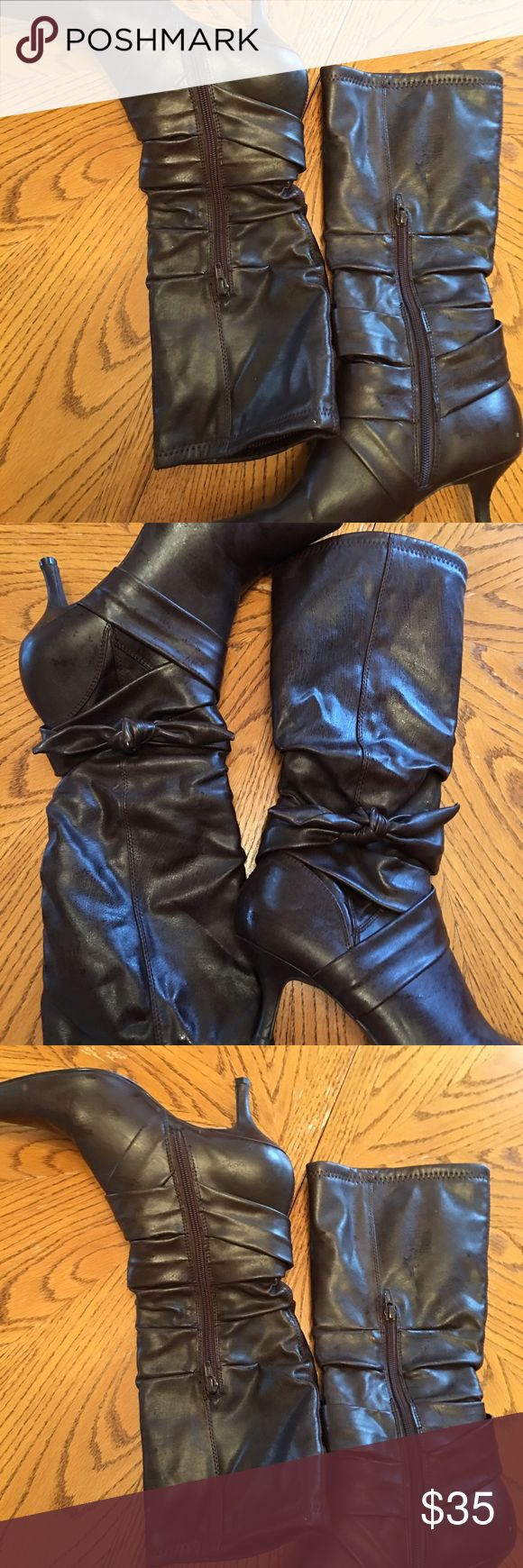 Black dress boots size 8. Black sexy dress boots with a bow with a little heel gorgeous!!!!!size 8 New without tags. Shoes Heeled Boots