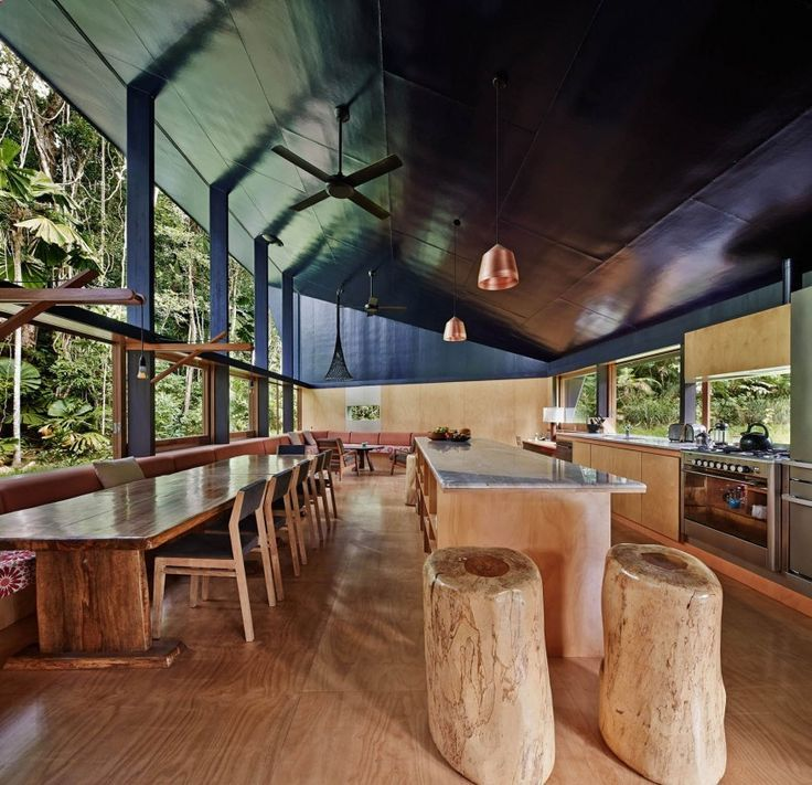 """An off the grid retreat has been built in the Daintree Rainforest inQueensland, Australia. Designed by M3 Architecture, the architectural piece connects the natural with the antropic and creates a bridge between the two. """"The exterior of the house is camouflaged with black plastic cladding and mirrored glass, allowing it to recede into the shadowRead more"""