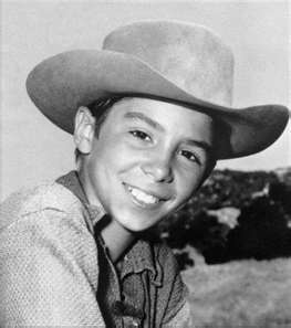 "Johnny Crawford as Mark McCain on ""The Rifleman"" with Chuck Conners as Lucas…"