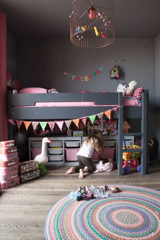 A little bit more from The Socialite Family. Dark gray and pink little girl's room