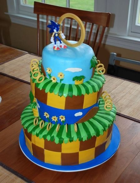 this is my dream cake!!! i wonder how they got the rings to stay up. The place he is in is called Green Hill Zone  :D