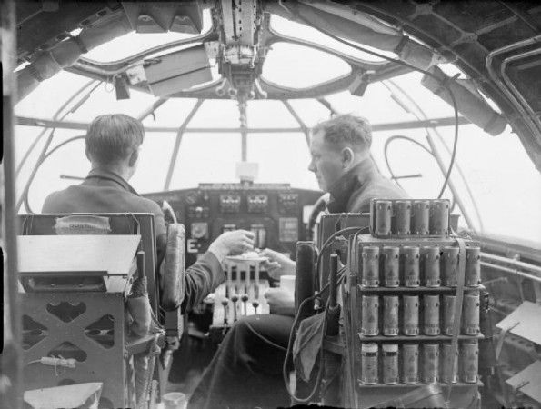 The pilot and navigator of a Short Sunderland Mark I of No. 10 Squadron RAAF enjoy some refreshments while on convoy escort duty in the Atlantic.