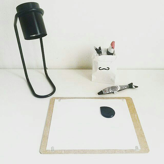 Dead fish and black crayon on white canvas...scary shit can come out of this. #halloween #nokonceptstore #theworkspacenextdoor #minime #lamp #boyacrayons #creative #creativityfound #white #blacknwhite #lavender #paperbag #decal #moustache