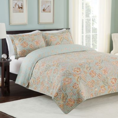 makeover your bedroom into a soothing sanctuary with the beautiful jovessa quilt adorned with a soft orange and green floral print the lovely pale blue