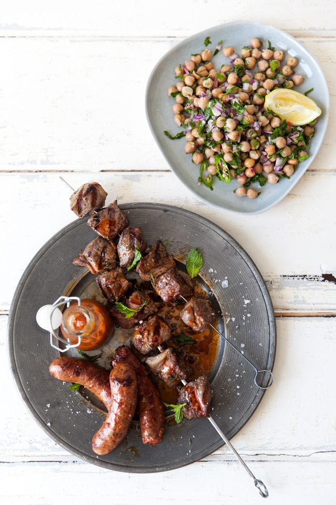 Lamb kebabs with spicy sausage and herb salad. Up your meaty game with this recipe.