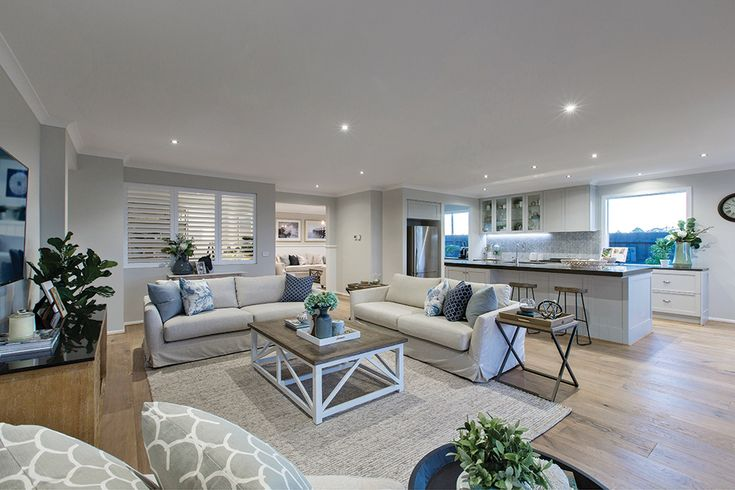 Family in the Vancouver display home with a Classic Hamptons World of Style.