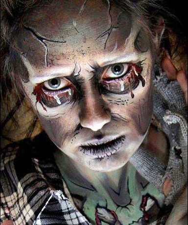 Go as a zombie without all the messy fake blood. Just use face paint instead to create hollowed-out eyes, gray lips, and a rotting rib cage. Photo courtesy Lynne Jamieson