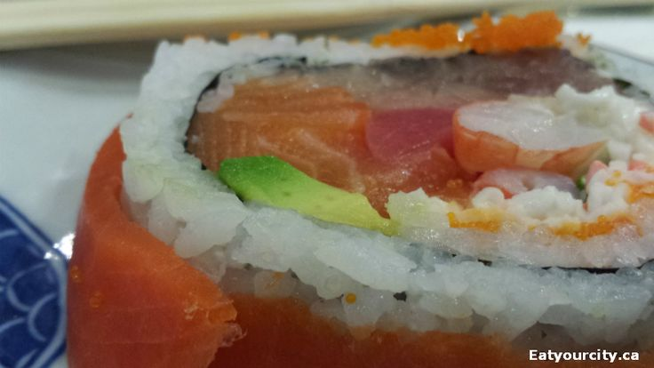 Alaska Roll Imitation Crab Meat, Masago, Avocado, Mayonnaise Wrapped with Smoked Salmon was huge and tasty
