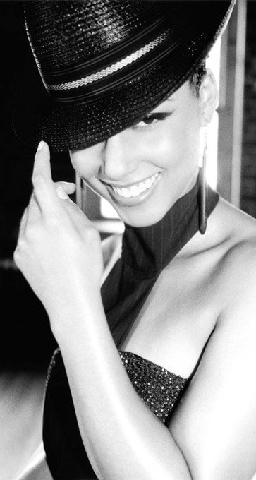 Alicia Keys - the beauty really comes out when the smile is real.