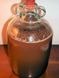 A nearly-full demijohn of Scrumpy cider