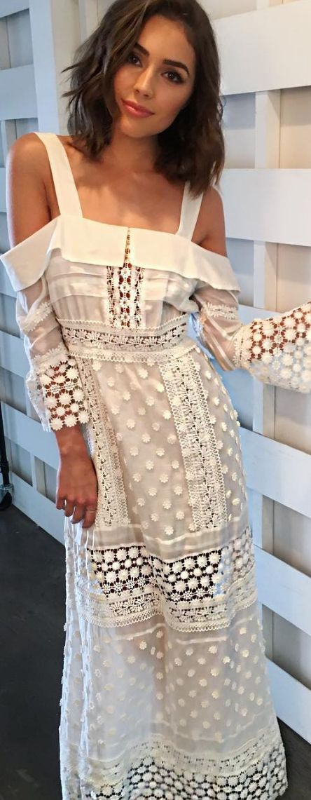 Who made Olivia Culpo's white lace maxi dress?                                                                                                                                                                                 More