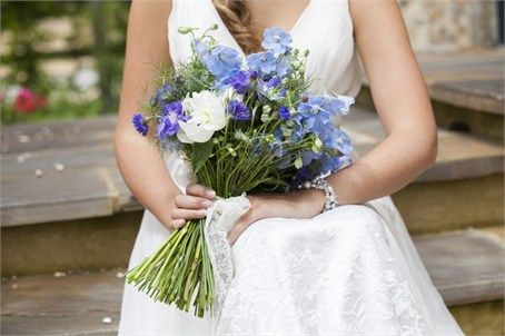 White peonies with delphiniums, cornflowers and love-in-mist are perfect for a sunny June wedding.