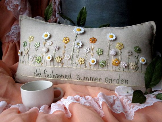 This summer-themed hand-made muslin needlework pillow is perfect for summer decor and fans of flowers and the sun! Size is approximately 16 x 8.