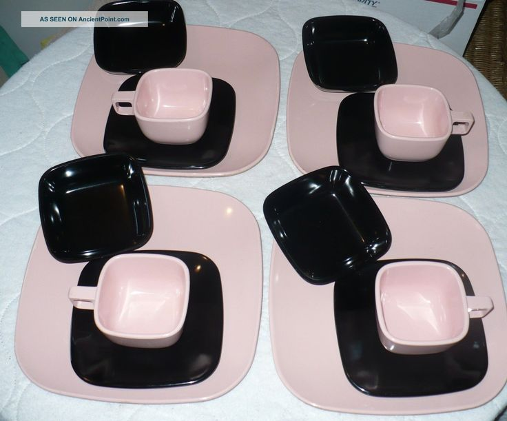 Brook Park ' Modern Design ' Melmac Dishes 4 Place Settings Pink & Black 1950s . We had these dishes but in different colors. It was hard to drink from the flat side of the cup without dribbling. Drinking from a corner was awkward. The cream pitcher had the handle on a corner. That's how they should have made the cups!