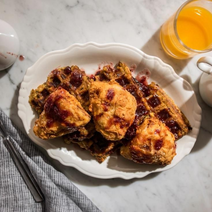 Deep-fried turkey gets served over crisp stuffing waffles with cranberry maple syrup for the ultimate post-Thanksgiving leftovers breakfast.