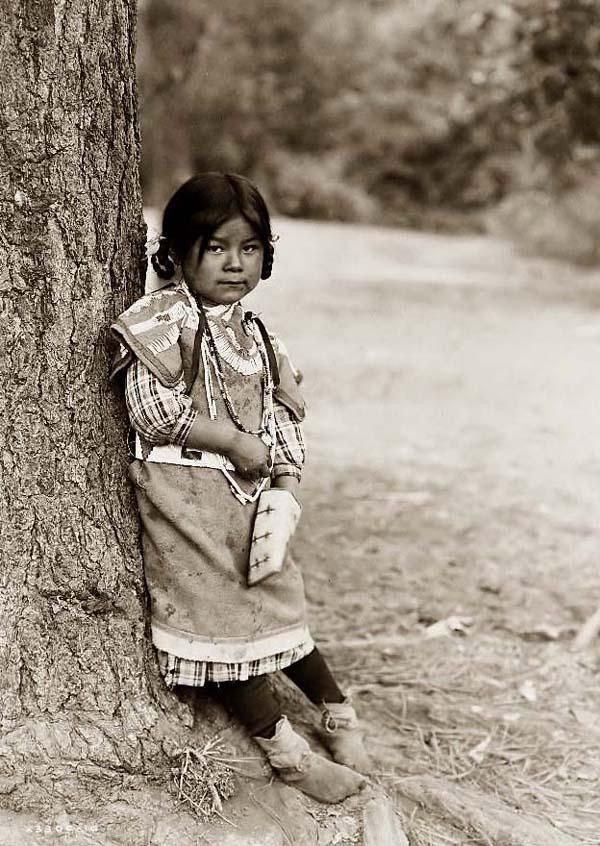 Umatilla Indian young girl in a Full-length Portrait.  It was taken in 1910 by Edward S. Curtis.