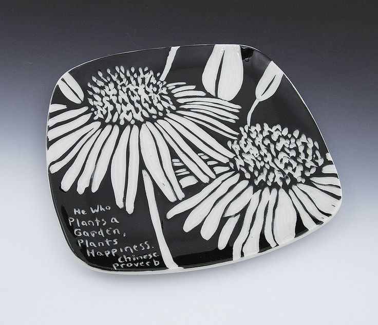 I based the carved sgraffito design of this hand-built porcelain plate on an oil painting I did many years ago.