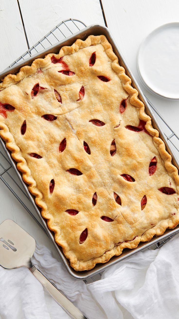 Need a crowd-pleasing summer dessert idea that won't take all day to make? Rhubarb and strawberries are the perfect combination in this easy-to-make slab pie.