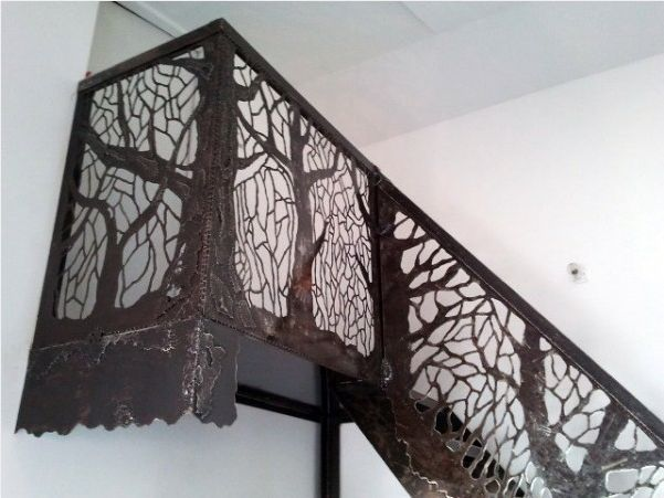 Stair/landing railing from cut out scrap metal.