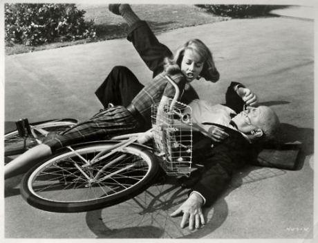 Jane Fonda rides a bike. Into Marc Connelly