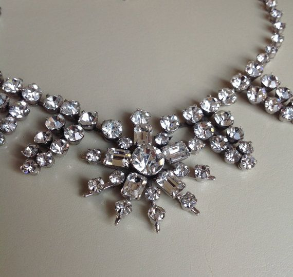 This is a stunning Vintage Diamante necklace in really wonderful condition.It measures approx 41cms and has perfect sparkling stones. No stones are missing or replaced. This statement piece would make a wonderful accessory for a special occasion.