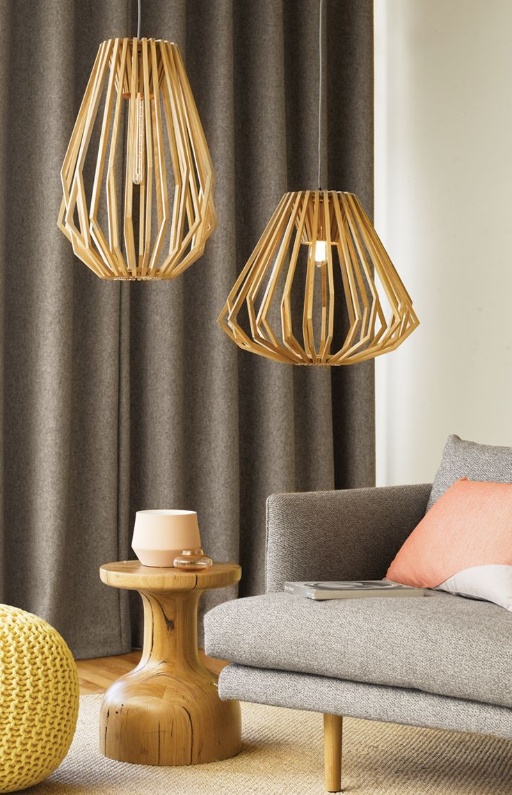 The Beacon Lighting Stockholm tall & squat pendant has a unique design consisting of numerous wooden slats which encircle the light globe creating a featured shadow effect.