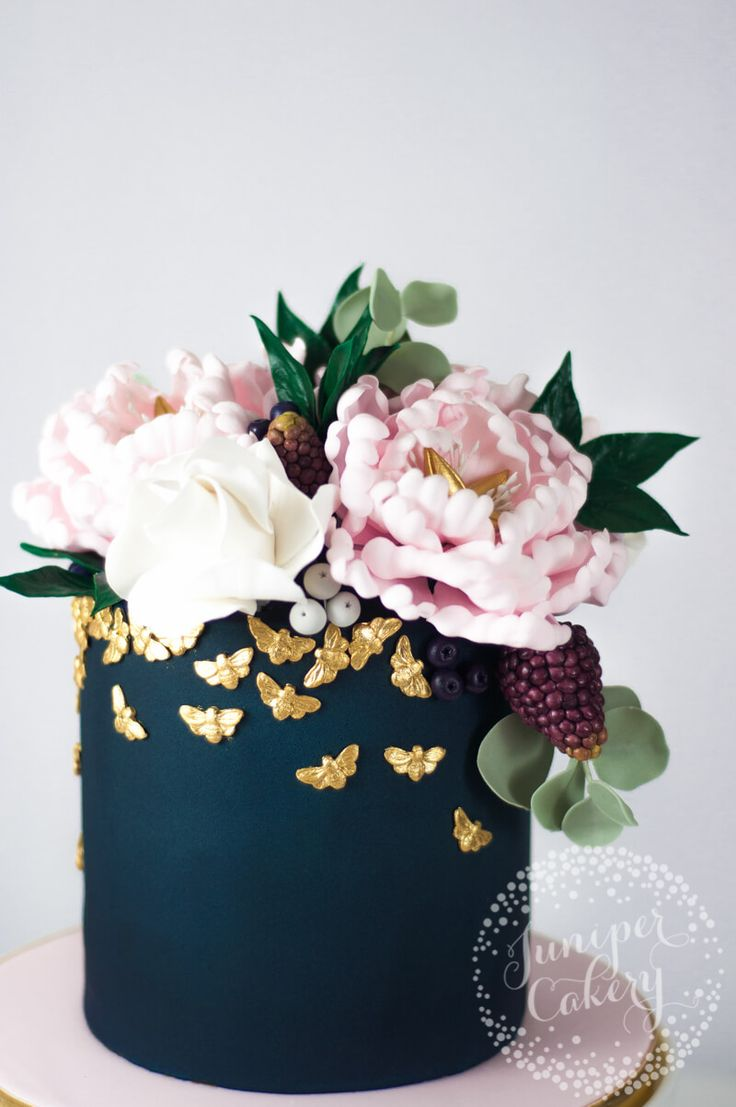 Combining glamour with nature this petite navy and blush peony cake studded with gold bees is perfect for grown-up parties!