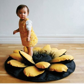 a soft flower shaped floor cushion & play-mat