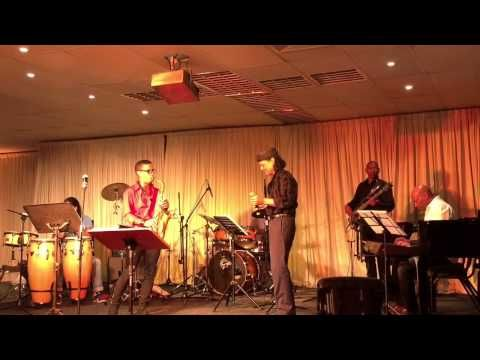"""Zayn Adam performing """"Give A Little Love"""" with the Glenn Robertson Jazz Band, on 23 January 2015..."""