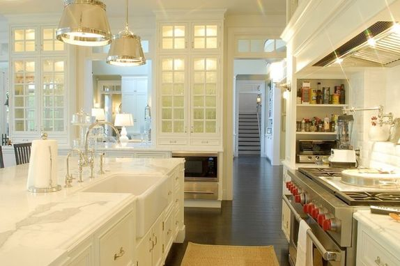 via Tumblr  Dream kitchen design with Wolf Range, Sandy Chapman Sloane Street Shop Lights with Metal Shades, farmhouse sink, spice rack, pot filler, sisal kitchen runner, white kitchen cabinets and marble counter tops.