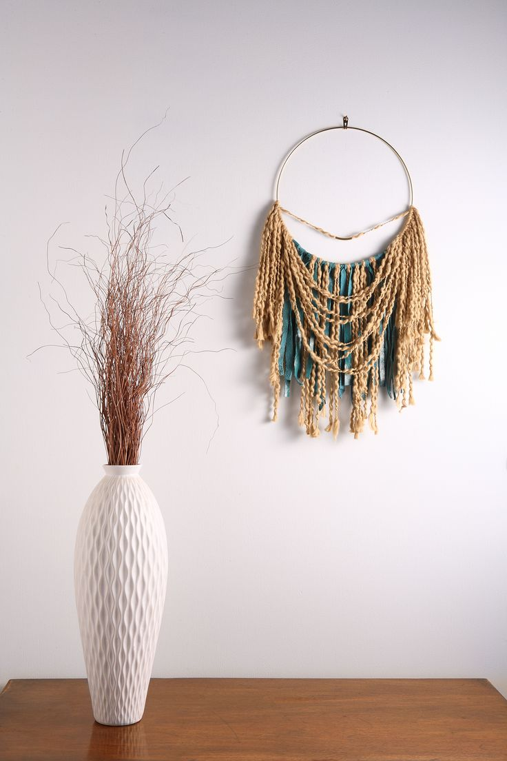 "Keep the bad dreams away with this ONE-OF-A-KIND Large Teal Leather Fringe Leather Dream Catcher Macrame Wall Hanging on 12"" Brass Hoop. This simple & elegant neutral color boho chic wall art / decor will look great in any room.  This piece is one of a kind. Its made with Fair Trade Organic Cotton and hand-cut genuine leather. A boho girl's dream!  Size: Large Materials: 100% genuine leather + Organic Cotton fibers + Brass Dimensions: 15""W x 27""L"
