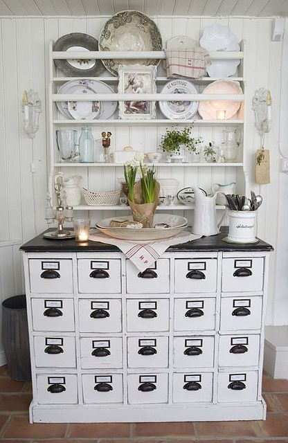 I'm not super wild about the stying in this pic, but I love the buffet! I could stain the top of mine dark like our cabs and paint the bottom light...