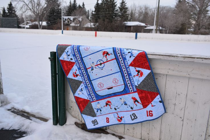 Hockey Quilt: Finished! I'll preface this post by saying that this quilt certainly isn't my usual style. But there's a reason for that: my husband designed it! He chose the theme, fabrics, layout, and...