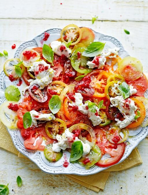 Tomato carpaccio with raspberries and burrata. The raspberries add a lovely tang to the salad that's incredible with the mozzarella and aromatic basil | Jamie Magazine