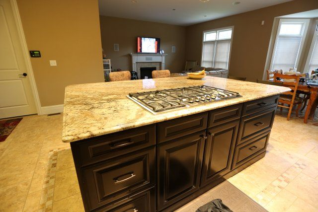 Typhoon Bordeaux Granite With Espresso Cabinets Granite