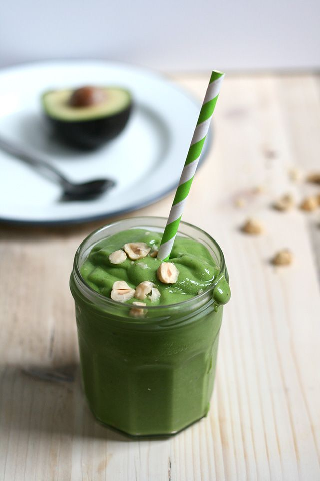 Green smoothie with avocado, spinach, frozen banana, hazelnuts & ginger