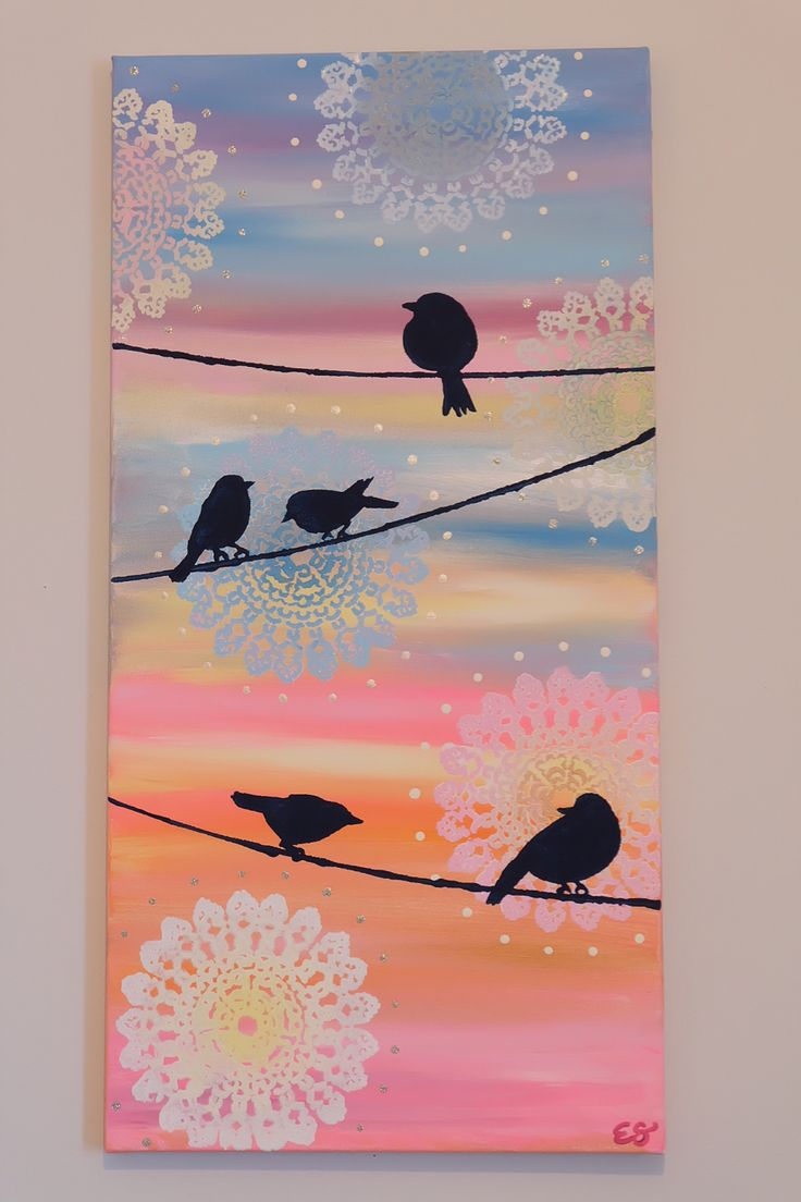 Rainbow birds on a wire