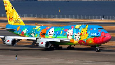 ANA Airways (All Nippon Airways) (JP) Historic fleet Boeing 747-481(D) JA8956 aircraft, painted in ''Pokemon (blue)'' special colors, skating at Japan Tokyo Haneda International Airport. 30/01/2011. (Pokemon blue=a role-playing video game by Game Freak published by Nitendo for the Game Boy). (The plane withdrawn from use 30/11/2012,stored at USA Mississippi Tupelo-Regional Airport 13/12/2012).