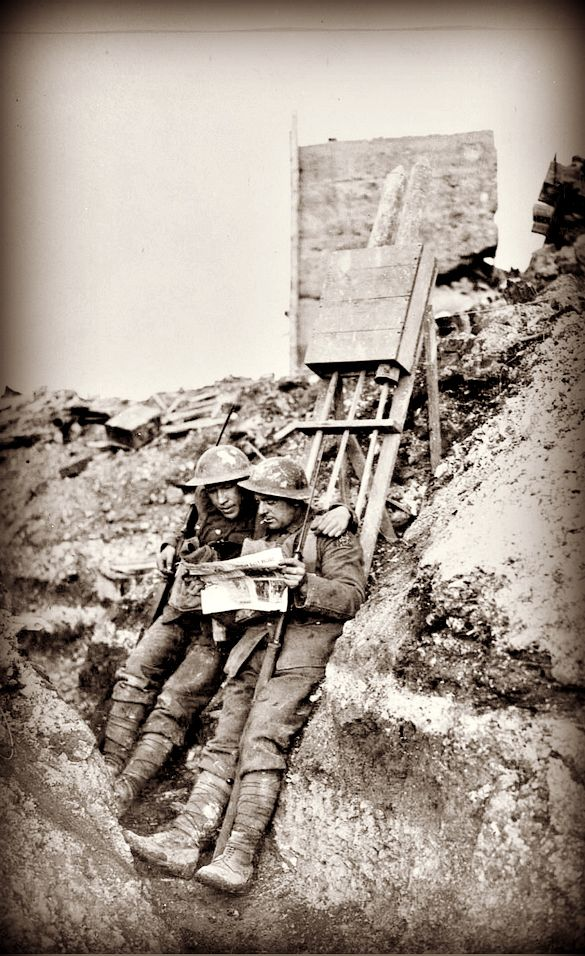 WWI, Feb 1918; Two Canadian soldiers within 200 yards of Heine's front line in Lens reading the Canadian Daily Record. -Library and Archives Canada.