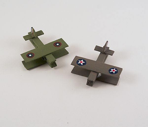 Making homemade toys just got a lot more fun with these Clothespin Military Airplanes! Your kids will love these simple clothes pin crafts. | AllFreeKidsCrafts.com