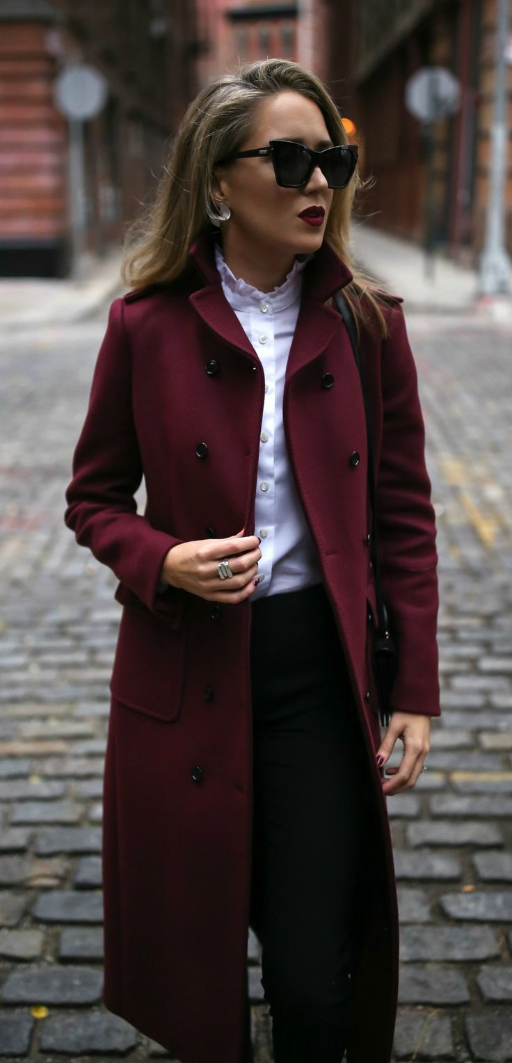Long burgundy double-breasted coat, metallic silver ankle strap pump, tailored high-waisted black pants, white ruffle blouse, black shoulder bag, deep red lip { Saint Laurent, Valentino, Theory, winter style, what to wear to work, holiday outfits, casual