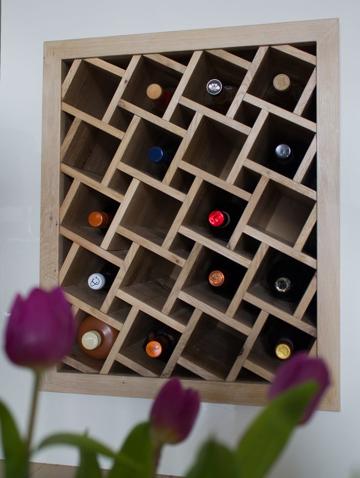 Built-in wine rack. http://meubelatelier-pvdborne.nl/index.php/project/inbouw-wijnrek/