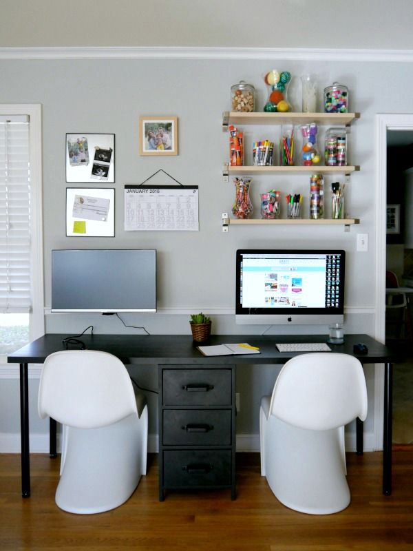 DIY a two person desk to make an organized and practical workspace! I LIKE HOW THEY MOUNT THEIR MONITORS ON THE WALL.
