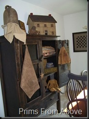 Prims...cupboard, olde crock, textiles & wooden house.