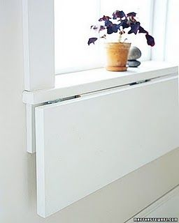 .folding table for laundry room on hinges.