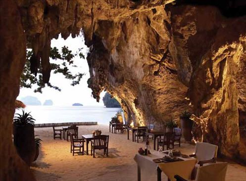 The Grotto restaurant, in Hotel Rayavadee in Krabi, Thailand, inside an ancient limestone cliff on the edge of Phranang Beach. The cave, with a floor of fine-powdered sand, opens on the beach. Shoes are optional, presumably.
