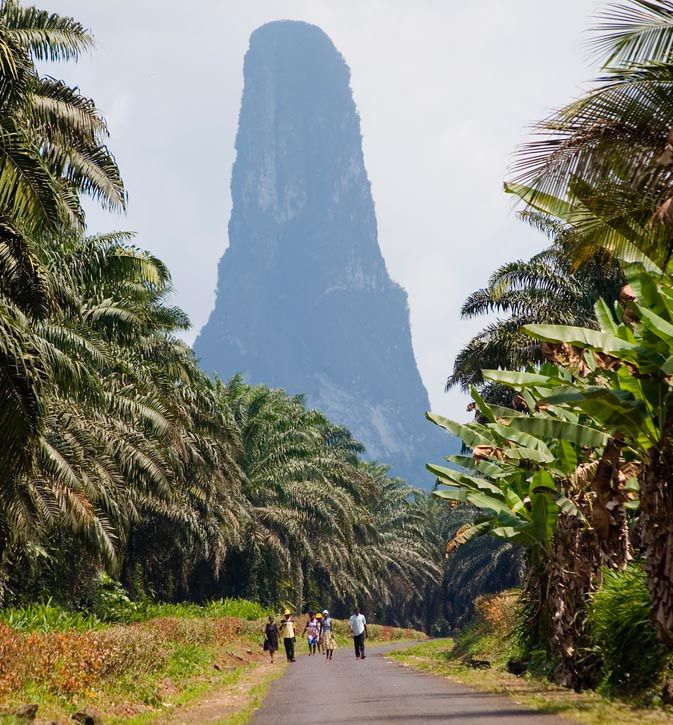 "Sao Tome and Príncipe, paradise islands in Africa -  Pico Cão Grande, or the Great Dog peak in Sao Tom is one of the highest needle-shaped ""volcanic plug"" peaks on Earth standing at 300 m"