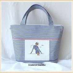 Collection bord de mer. sac zippé brodé  «une femme marine» broderie point de croix rue du port